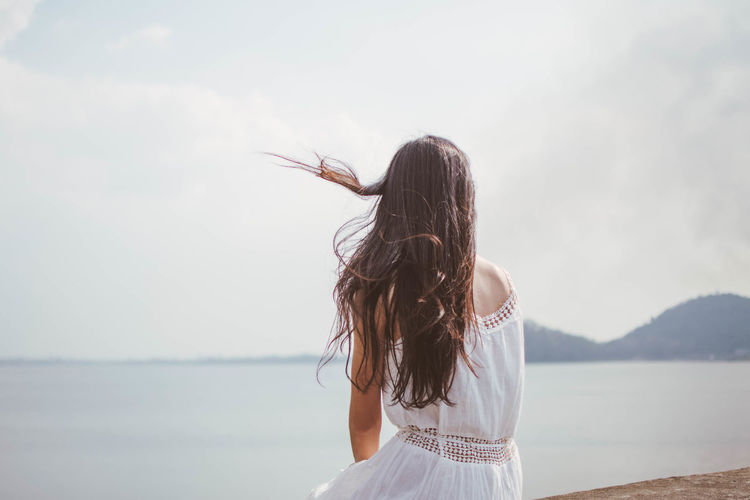 Alone Day Focus On Foreground Horizon Over Water Leisure Activity Lifestyles Long Hair Nature One Person Outdoors People Real People Rear View Sad Sea Sky Standing Water Young Adult