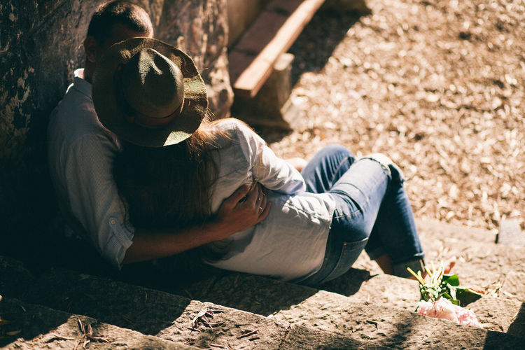 High Angle View Of Loving Couple Sitting On Steps