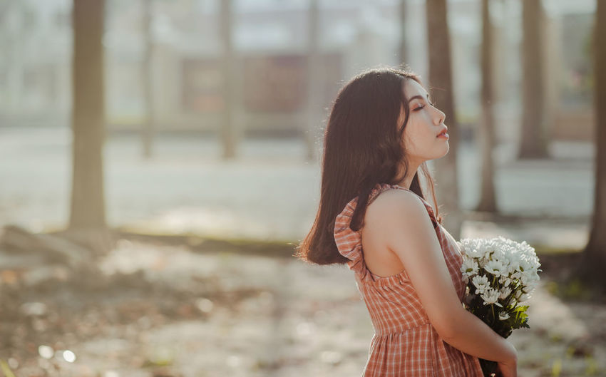 In some corners of Viet Nam Adult Adults Only Beautiful Woman Day Focus On Foreground Leisure Activity Lifestyles Long Hair Nature One Person Outdoors People Real People Side View Standing Young Adult Young Women This Is Natural Beauty