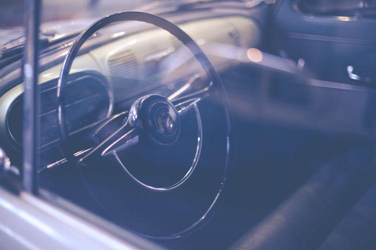 Steering wheel seen through window