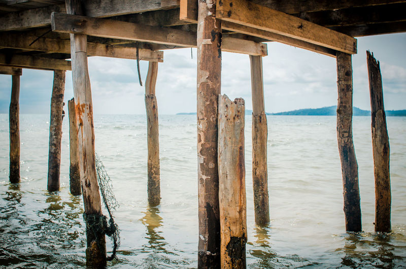 Underneath view of pier in sea