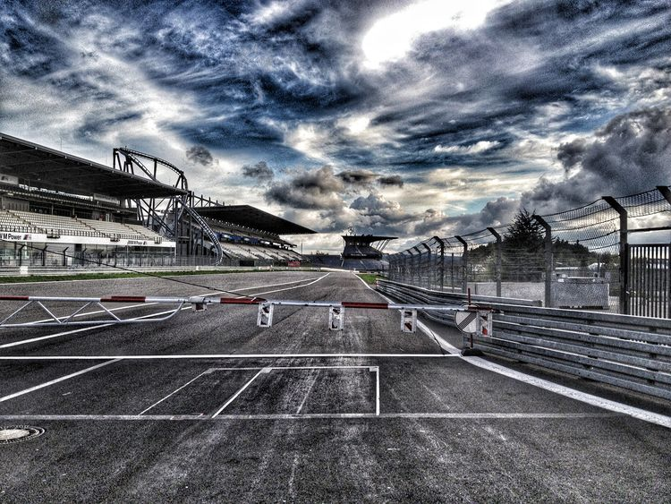 Racetrack is closed Pitlane Nurburgring Motorsport Racing Cloud - Sky Architecture Built Structure Sky Dramatic Sky Building Exterior Sports Track EyeEmNewHere EyeEmNewHere