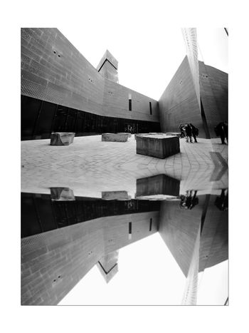All About Angles 7 DeYoung Museum Reflection San Francisco CA🇺🇸 Golden Gate Park Bnw_friday_eyeemchallenge Museum Time Fine Arts Museum Entry Courtyard Entrance Architecture Architectural Detail Façade Perforated & Dimpled Copper Plates Stone Tiles Monochrome_Photography Monochrome Black & White Black & White Photography Black And White Black And White Collection  Drawn Stones Seating 1st Museum Built 1895 Severely Damaged 1989 Loma Prieta Earthquake New Museum Opened 2005 Architecture_collection