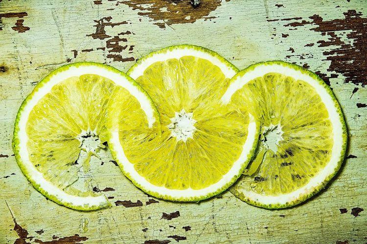 Directly above shot of lemon slice on table