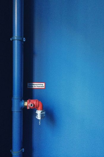 Gas Pipe On Blue Wall