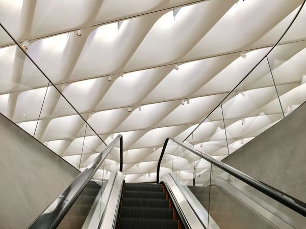 EyeEm Selects Indoors  Steps And Staircases Staircase Escalator Steps Railing Modern Architecture Convenience Built Structure Technology Futuristic No People Day Broad Artmuseum Skylight Diagonals Light And Shadow The Broad Museum