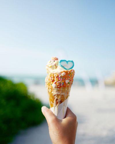 Happy scoop ice cream with the sea background.