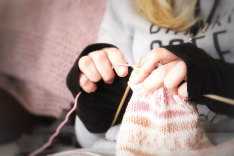 Close-Up Of Woman Knitting Wool