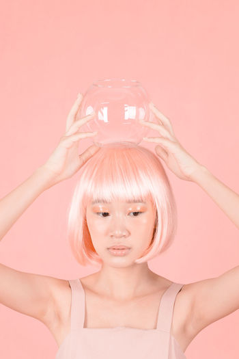 lab 4 Futuristic Portrait Of A Friend Pink Color Salmon Colored Fish Bowl Studio Shot Wig Makeup Make-up Fine Art Photography Colored Background Only Women Adults Only Pink Color One Woman Only One Person Front View Studio Shot Portrait Close-up Beautiful Woman Science Technology Love Yourself