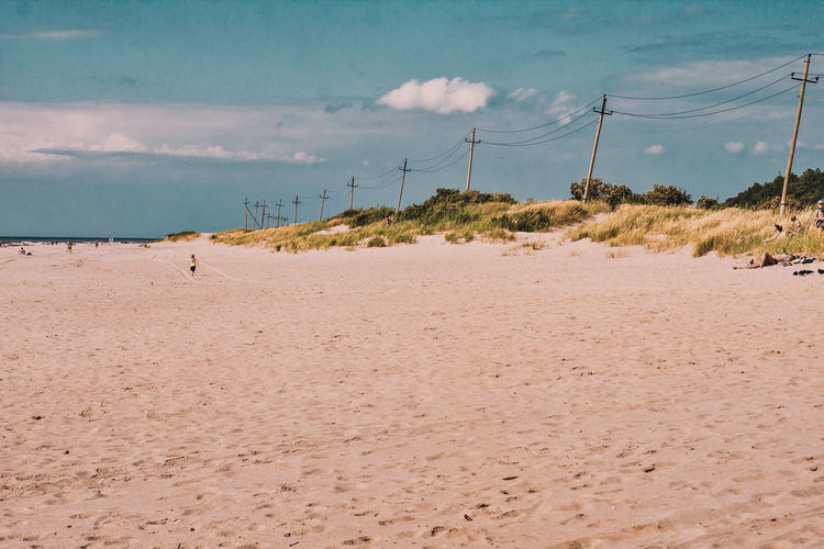 Coast and power supplies Sky Cloud - Sky No People Sand Outdoors Scenics Nature Landscape Day Power Supply Coast Baltic Miles Away The Great Outdoors - 2017 EyeEm Awards