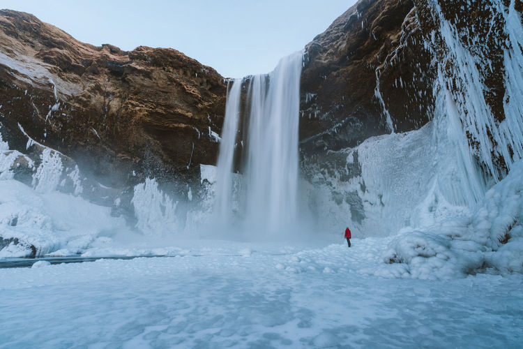 find more travel inspiration at https://www.instagram.com/simonmigaj Iceland Travel Travel Photography Winter Adventure Beauty In Nature Cold Temperature Day Long Exposure Motion Mountain Nature One Person Outdoors People Real People Rock - Object Scenics Skogafoss Sky Snow Water Waterfall Winter Go Higher
