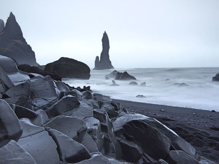 Cloudy Iceland Beauty In Nature Black Sand Beach Black Sand Beach Iceland Cold Grey Sky Nature No People Rock - Object Rock Formation Scenics Sea Tranquility Wet Rocks