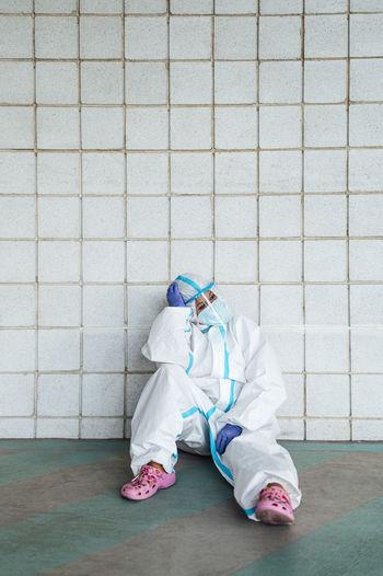 Full length of child on white wall
