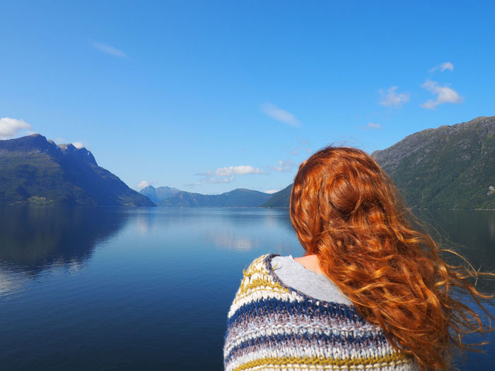Fyord Norway Norway🇳🇴 Adventure Beauty In Nature Blue Ginger Girl Lake Landscape Leisure Activity Long Hair Mountain Mountain Range Nature One Person Outdoors Real People Rear View Redhead Scenics Sky Sweater Tranquil Scene Tranquility Water