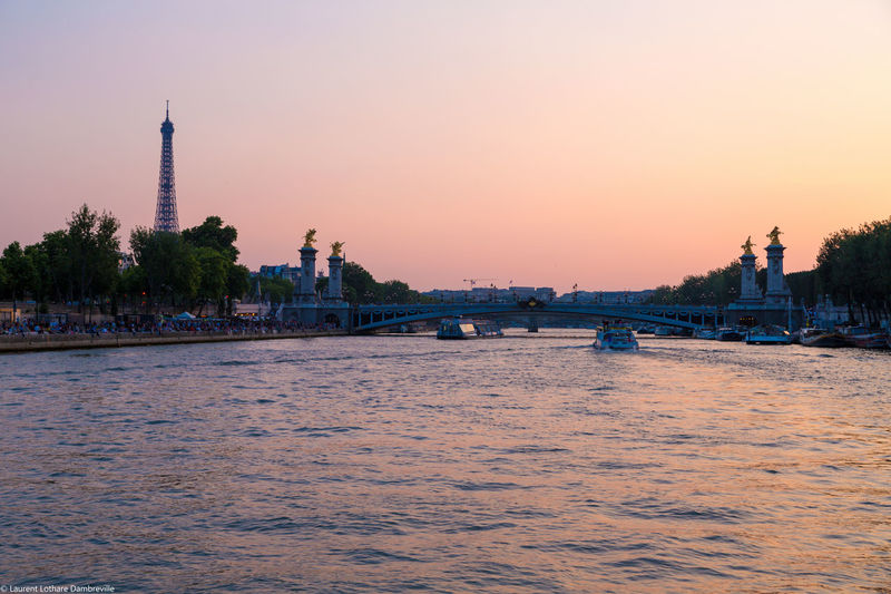 Paris from the boat Architecture Bridge Bridge - Man Made Structure Built Structure Connection Distant Eiffel Tower Engineering International Landmark La Seine Mid Distance Ocean Outdoors Paris Pont Alexandre III River Sky Sunset Tour Eiffel Tourism Traveling Tropical Climate Voyage Water Waterfront