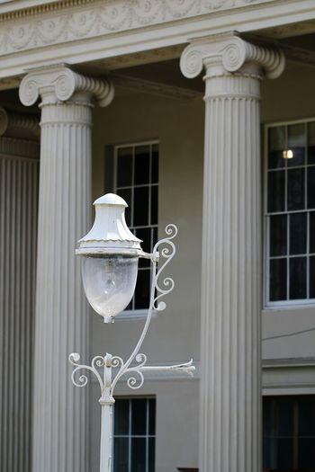 Street light against building