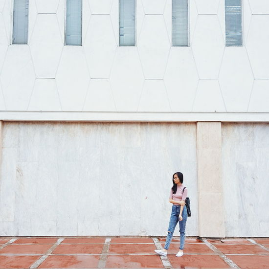 Full length of a woman standing in city