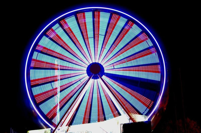 Illuminated Ferris Wheel Multi Colored Arts Culture And Entertainment Amusement Park Concentric Amusement Park Ride Blue Circle Sky