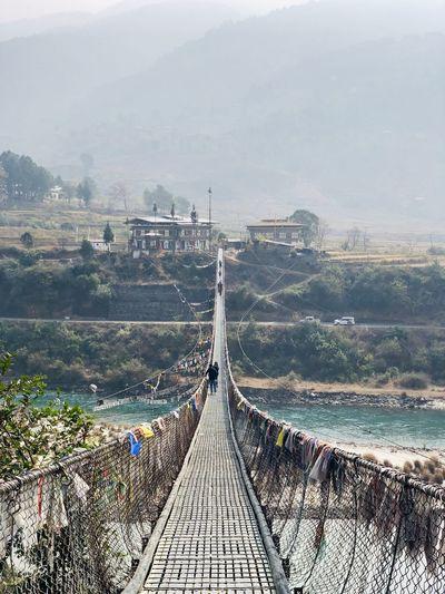 Footbridge leading towards mountains