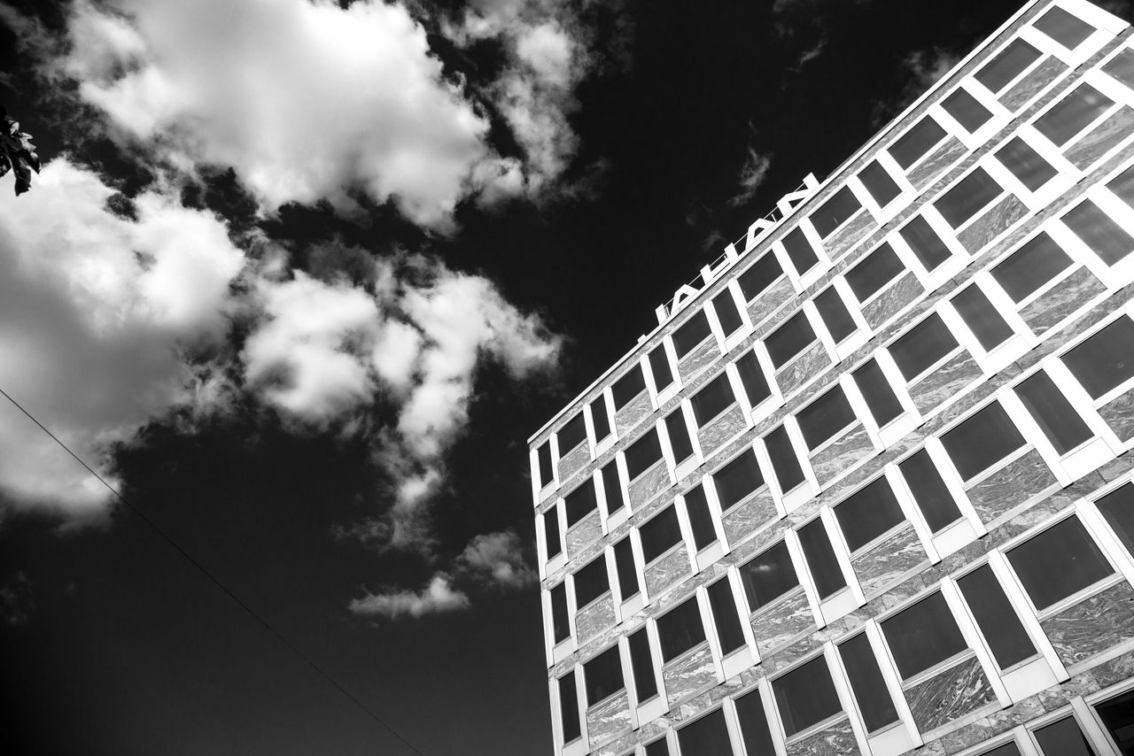 low angle view, architecture, day, building exterior, sky, no people, window, outdoors, built structure, growth, tree, nature