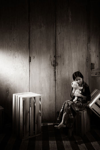 Girl with toy against wall