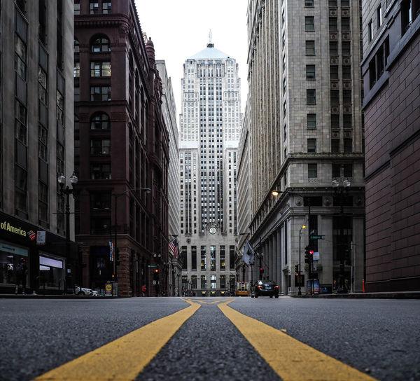 Road amidst buildings in city