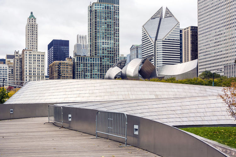 BP pedestrain walkway over the Millennium Park in Chicago Architecture Building Exterior Built Structure Chicago City Cityscape Day Millennium Park Modern Outdoors Park Pedestrian Real People Sky Sky And Clouds Skyscraper Skyscrapers Urban Skyline Walkway Wooden