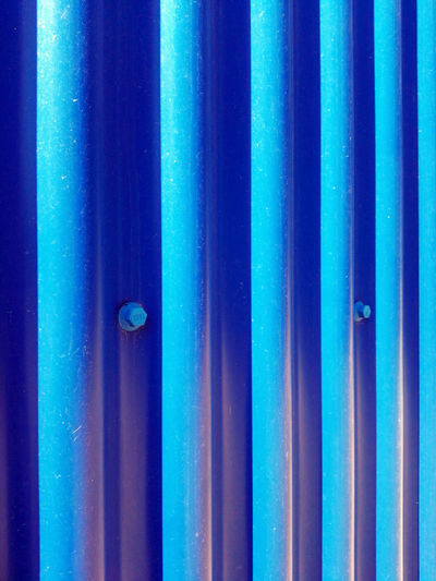 Nice wall Architecture Backgrounds Blue Bolt Close-up Corrugated Iron Full Frame Lines Lines, Shapes And Curves Metal Screw Simerty Vertical Composition Vertical Symmetry Art Is Everywhere Neon Life