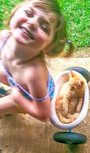 CyclingUnites Outdoors Child Children Child Playing Child Riding Girl Kitten Girl Power Trike Cycle Bike 3 Wheels Silly Silly Girl Cat Portrait Beauty Childhood Childhood Memories Family Catsofeyem Pets Making Memories Relaxation Funny