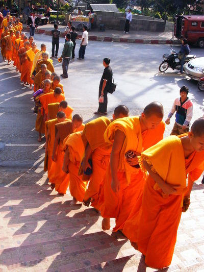 High Angle View Of Monks Moving Up On Steps