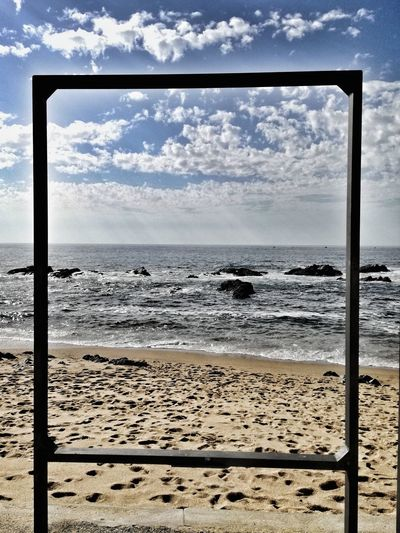 Sea Beach Water Horizon Over Water Sand Sky Day Nature No People Tranquil Scene Cloud - Sky Scenics Framed Vision Outdoors Tranquility Frame Within A Frame Frame In Frame Art Is Everywhere The Graphic City