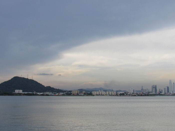 View of city by sea against sky