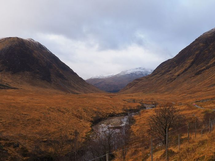 Beautiful autumnal Glen Etive EyeEm Best Shots Glen Etive James Bond Mountain Sky Cloud - Sky Scenics - Nature Tranquil Scene Tranquility Beauty In Nature Environment Landscape Non-urban Scene Nature Mountain Range Day No People Land Idyllic Outdoors Remote Rock Physical Geography
