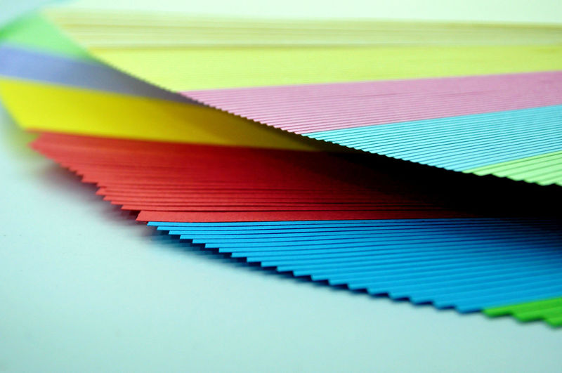 Close-up of multi colored papers on table