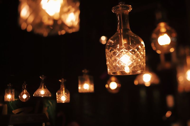 A cinematic night out experience Cinematic Photography Interior Design Illuminated Lighting Equipment Night No People Glowing Electricity  Close-up Indoors  Light Hanging Decoration Focus On Foreground Electric Light Light Bulb Glass - Material Transparent In A Row Low Angle View Technology Light - Natural Phenomenon