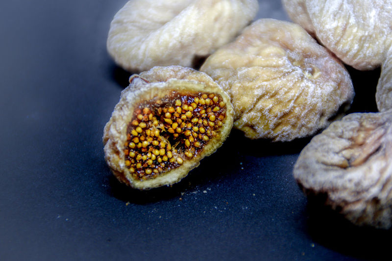 Close-up of dried fig fruits on table