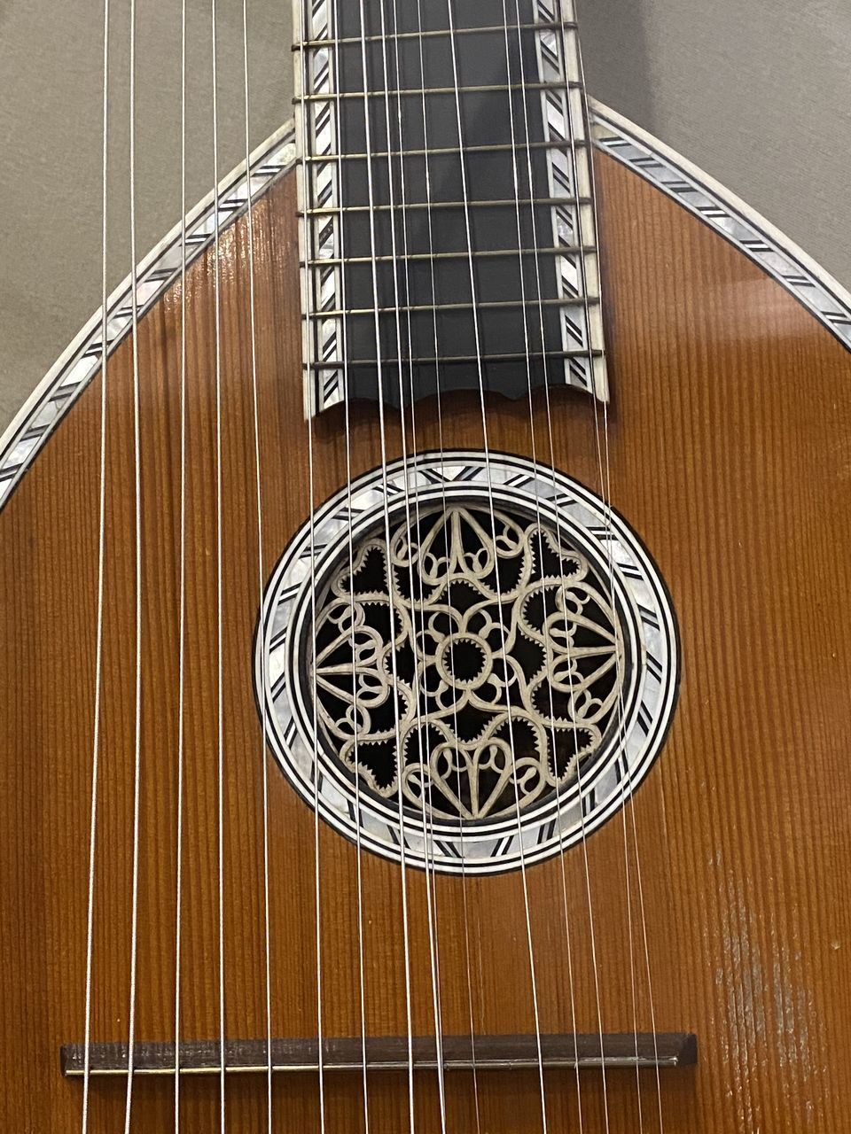 indoors, no people, wood - material, musical equipment, close-up, musical instrument string, musical instrument, string instrument, metal, string, music, arts culture and entertainment, table, high angle view, brown, day, pattern, directly above, architecture