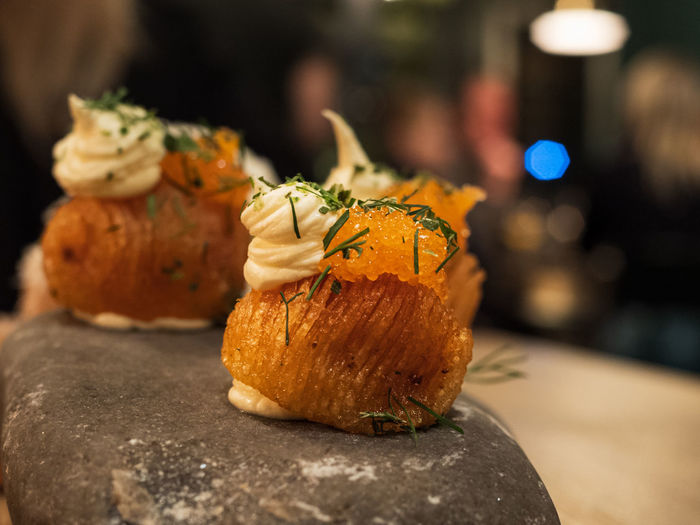 Close-up of tiny baked potatoes topped with caviar