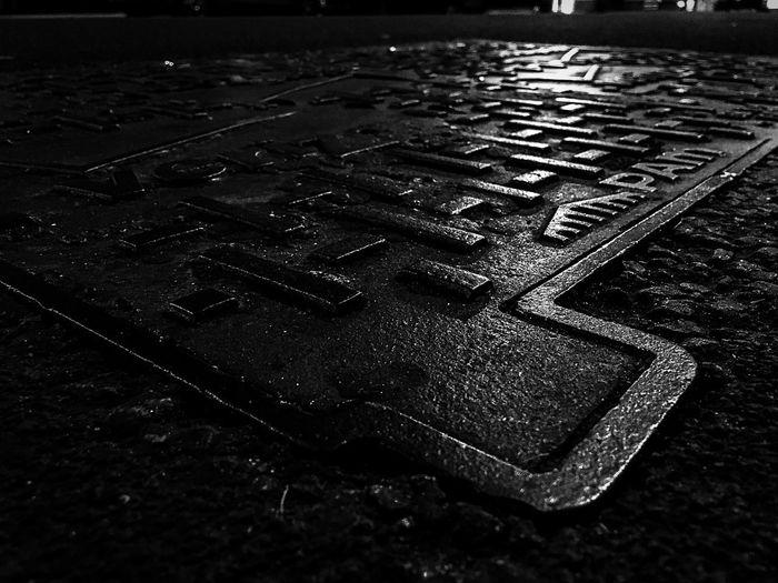 Drain Cover Creative Photography Streetphotography Urban Exploration Artistic Metallic Nightphotography Dark The Week Of Eyeem Showcase July Tarmac Weathered Fine Art Tonal Man Hole Cover