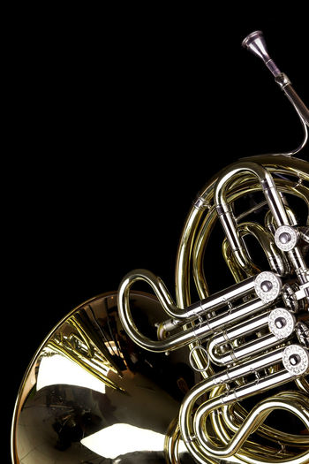 Music Instrument French Horn, French horn Isolated on black Music Musical Instrument Arts Culture And Entertainment Studio Shot Brass Instrument  Black Background Indoors  Metal Musical Equipment Brass Wind Instrument Copy Space Close-up Still Life No People Trumpet Gold Colored Shiny Cut Out Reflection
