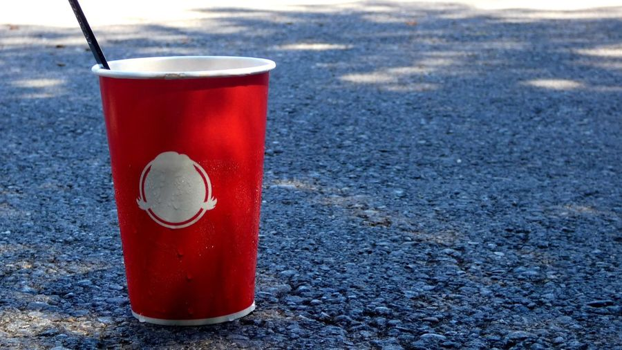 A Wendy's cup someone didn't throw out found in a Costco parking lot. People need to clean up after themselves. 😞 Fast Food Drinks Drinks And Food People Earth Clean Earth White Offwhite Shade Shade Of Tree Light Light And Shadow Drink Garbage Loitering Littering Littered Street Parking Lot Parking Gross Cleaning Clean Cleanup Cleanuptime Red Close-up Food And Drink Soda Drinking Straw Canister