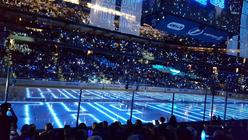 Large Group Of People Illuminated Leisure Activity Lifestyles Stadium Spectator Person Crowd Enjoyment Performance Stage - Performance Space Fun Event City Life Vacations Tampa Hockey Playoff Lightning Blue Crowd Ice Rink Laser Show