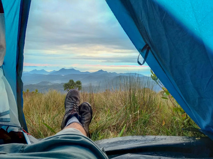 Camping Montains    Low Section Human Leg Shoe Personal Perspective Car Sky Close-up