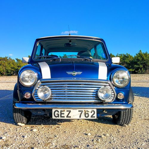 Classic Rover Mini Cooper 1998 Blue Car Classic Communication Composition Control Cool Day Mini Cooper Minimalism No People Obsolete Old-fashioned Part Of Perspective Retro Retro Styled Shiny Sky Transportation Vintage