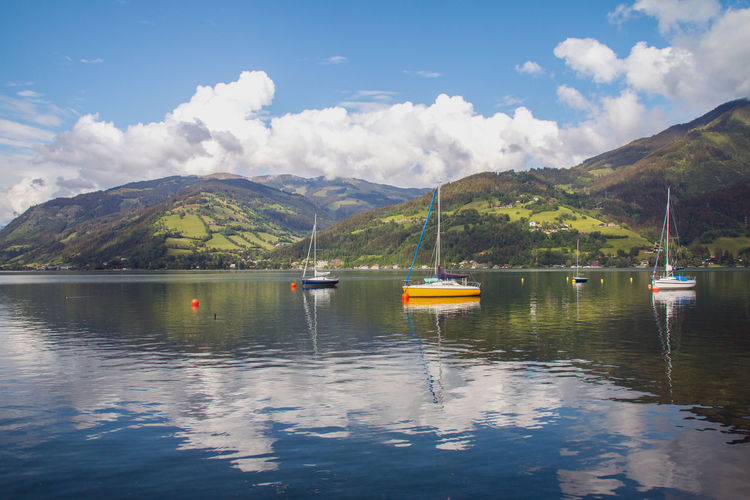Sail boats at Zell Am See lake in Austria Austria Boat Europe Mountain Mountain Range Nature Nautical Vessel Outdoors Sailboat Scenics - Nature Sky Tourism Tourism Destination Water Zell Am See