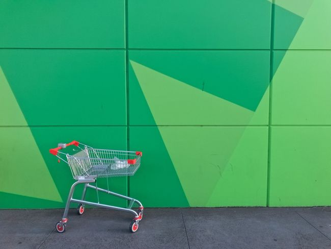 Lone shopping trolley seeks partner for lurid exchange of bodily fluids Alone Australia Preston Shape Solitary Urban Geometry Victoria Wall Alone... Consumerism Day Green Color Lonley Melbourne No People Pattern Red And Green Retail  Shopping Cart Solitude Supermarket Trolley Urban Urban Landscape Urbanphotography