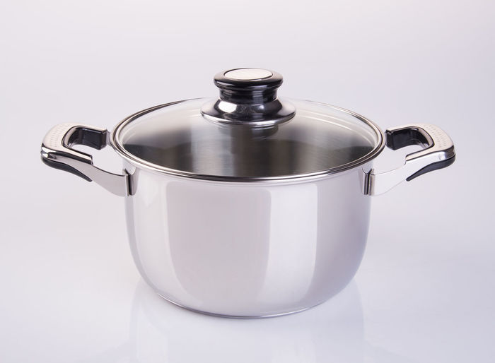 Close-up Cooking Pan Crockery Cut Out Food Food And Drink Household Equipment Indoors  Kitchen Utensil Lid Metal No People Pan Saucepan Silver Colored Single Object Stainless Steel  Steel Still Life Studio Shot White Background