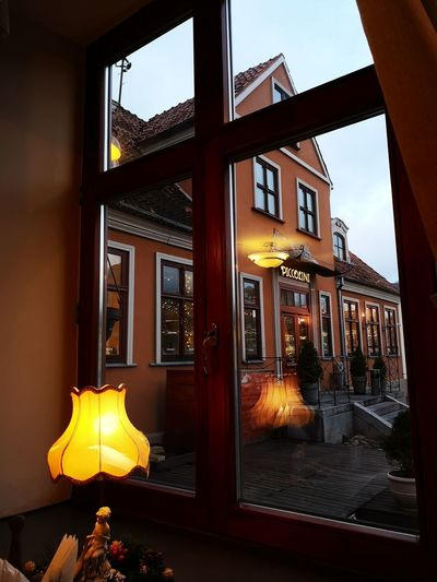 Old fashioned light Capture Tomorrow City Cityscape Window Architecture Built Structure Flame Residential Structure Lantern