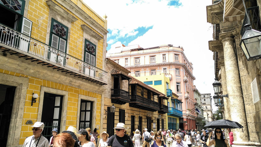 Cuban Style Cuba Streets Cuban Life Havana, Cuba Building Exterior Architecture Built Structure Large Group Of People Outdoors Real People Low Angle View Day City Sky People Adult Adults Only