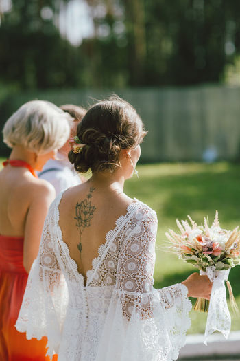Rear view of woman during wedding